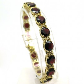 Bijoux d'occasion Paris - Bracelet vintage en or jaune serti de grenats Monge 198