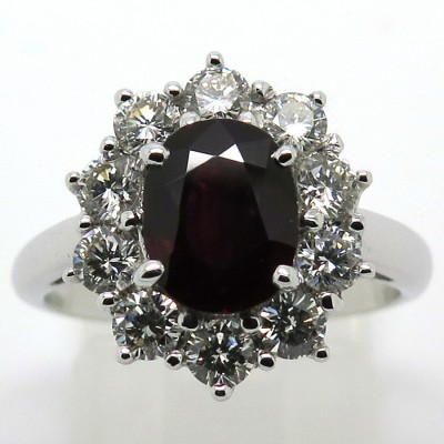 Bague marguerite rubis entourage diamants monture en or blanc 1711