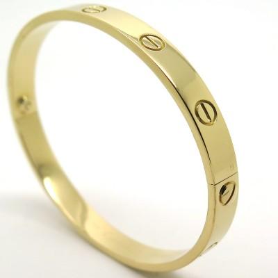 CARTIER - Bracelet Cartier Love en or jaune 215 - Bijouterie Cartier  d occasion 8436c3af4761
