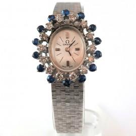 Montre en or blanc saphirs et diamants de marque Oméga 122