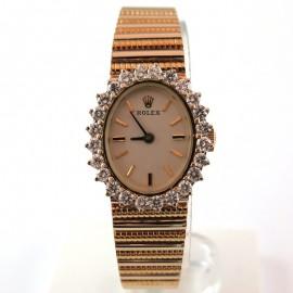 Montre de marque ROLEX en or au cadran entouré de diamants 116